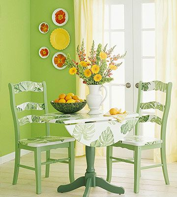 wallpaper scraps added to kitchen chairs and dining table