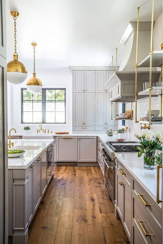 The floors are California Classics – Mediterranean Collection – French Oak – Color is Khaki. The suspended brass shelves are custom fabricated from Brandino. The hardware is from Restoration Hardware Modern. The island sink is Kohler 24″ x 18 1/4″ x 9 5/16″ under-mount single bowl. Cabinets Color: Gray Huskie by Benjamin Moore.