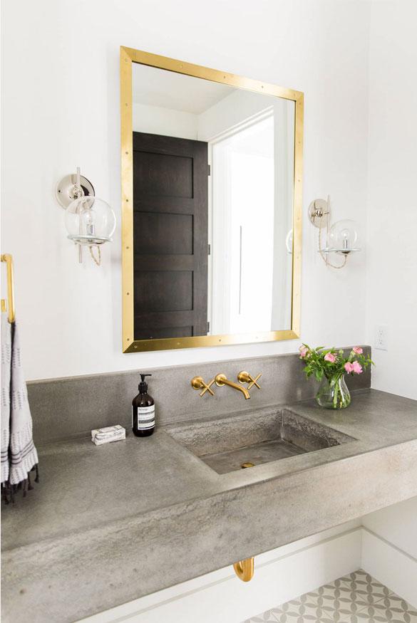 brass and concrete bathroom trend