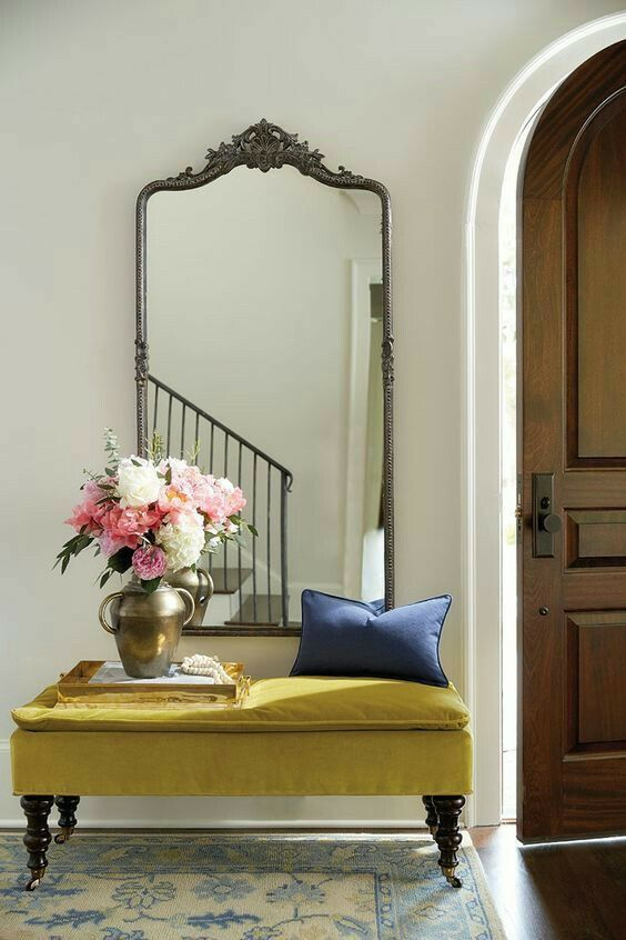 Ornate mirror with simple decor in the entry
