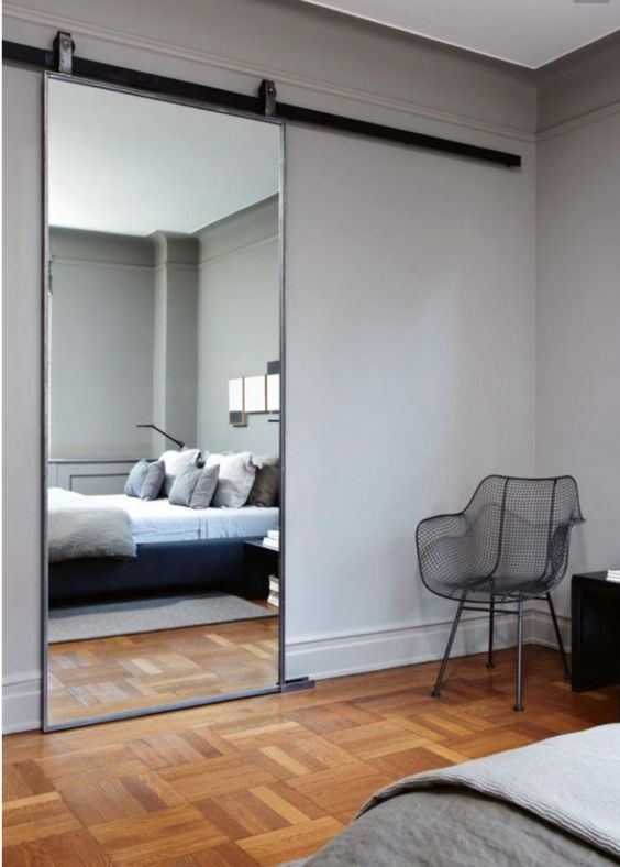 Mirrored bedroom barn door