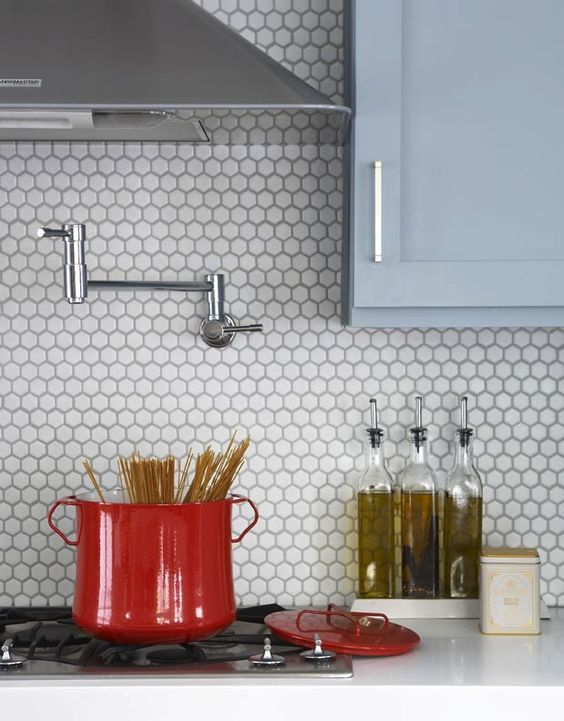 Refreshing to see how these classic hex tiles are used as a backsplash and not as a bathroom floor.