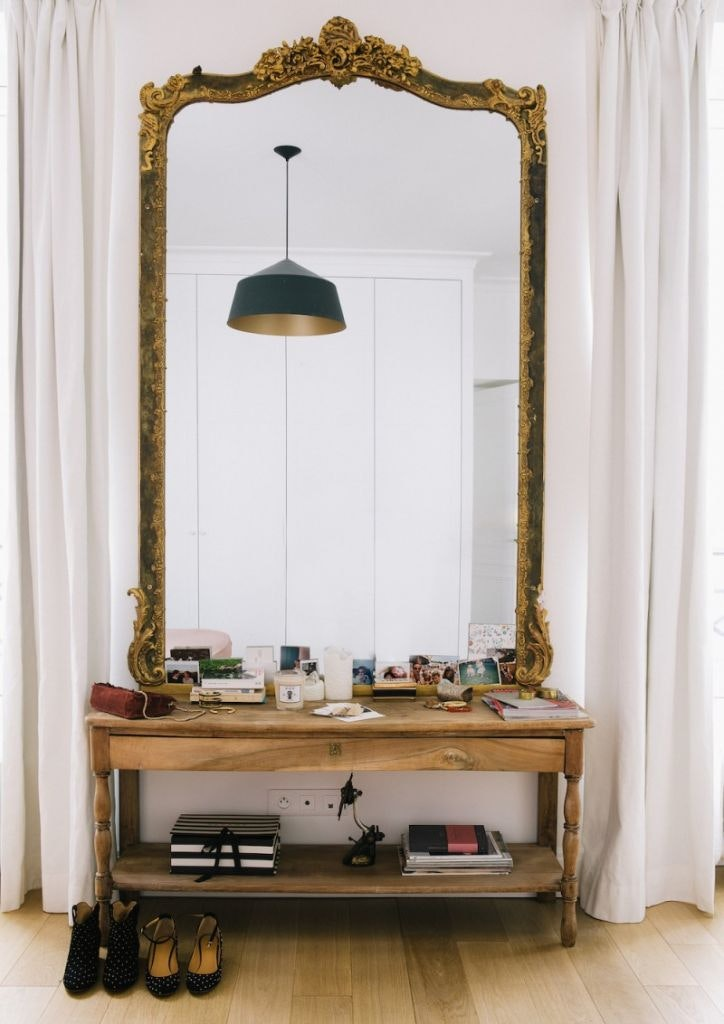 gilded mirror to the ceiling