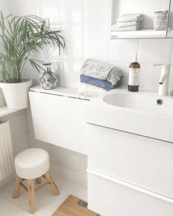 A Fold-Down Shelf Is Useful for Smaller Bathrooms