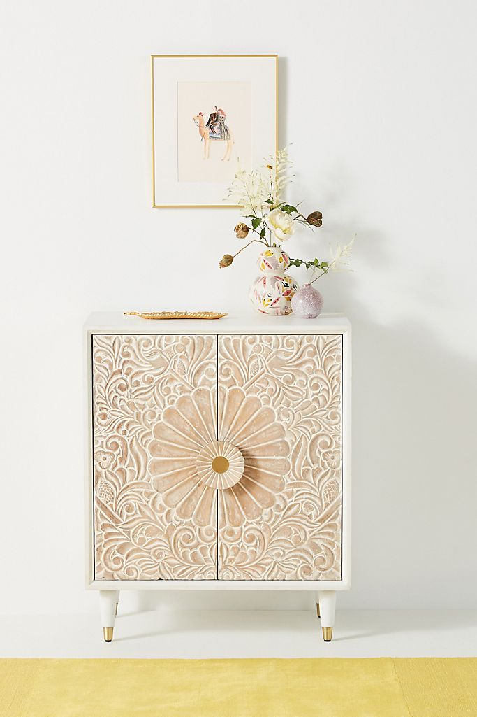 Spice Up Your Hallway With an Intricate Cabinet