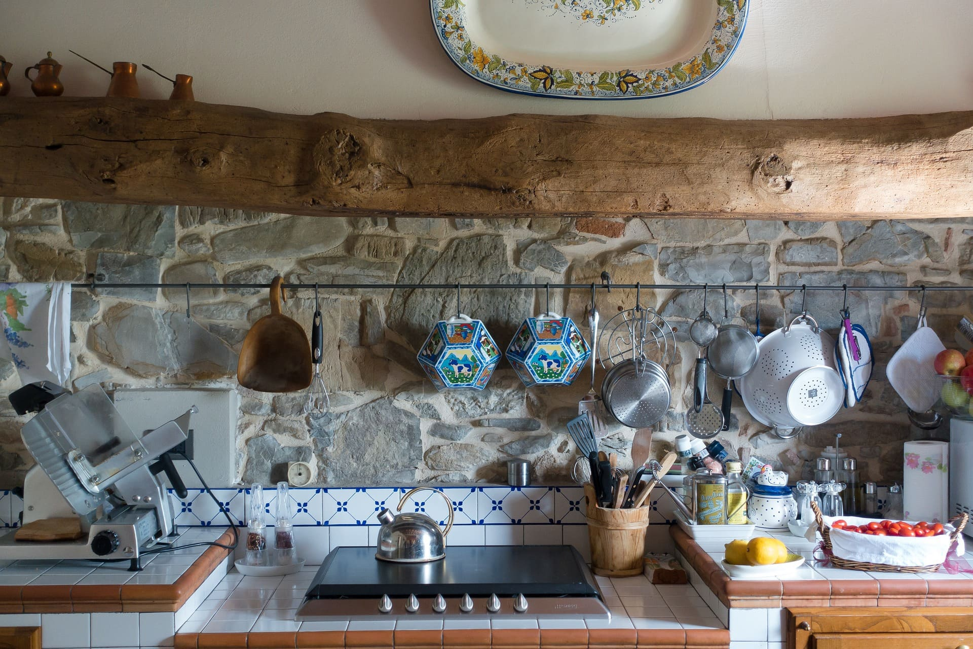 <strong>Deck Out the Kitchen with a Combination Hand Painted Tiles and Stones</strong>