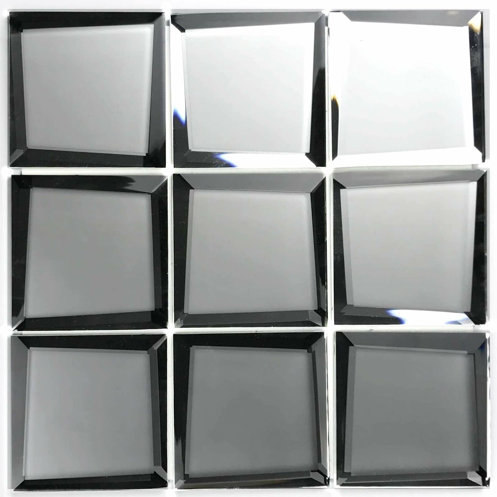 Try Beveled Mirror Tiles - Especially for Dark Rooms or Low Ceilings