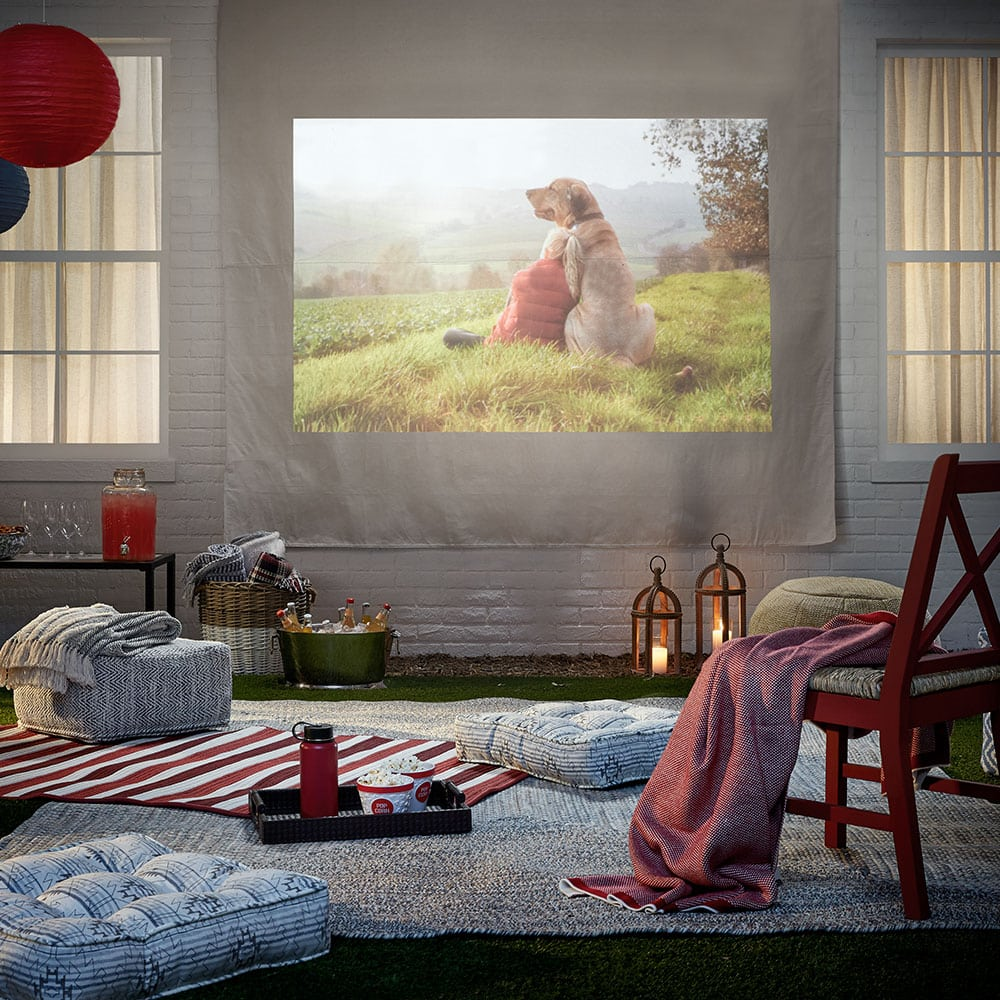 <strong>Hang a Sheet for Outdoor Movie Nights</strong>