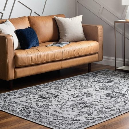 25 Gorgeous Rugs That Go With Brown Couches & Tie the Room Together