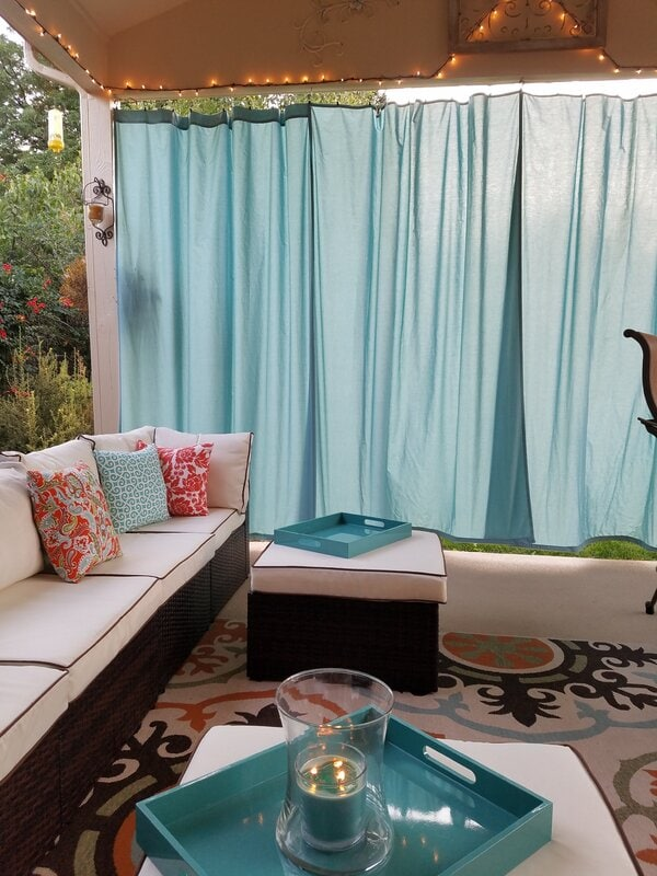 <strong>Make an Intimate Outdoor Living Room With Some Curtains</strong>