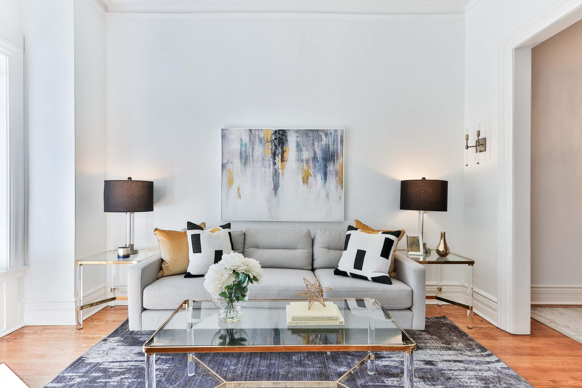 Black, White and Gold Throw Pillows on a Light Grey Sofa