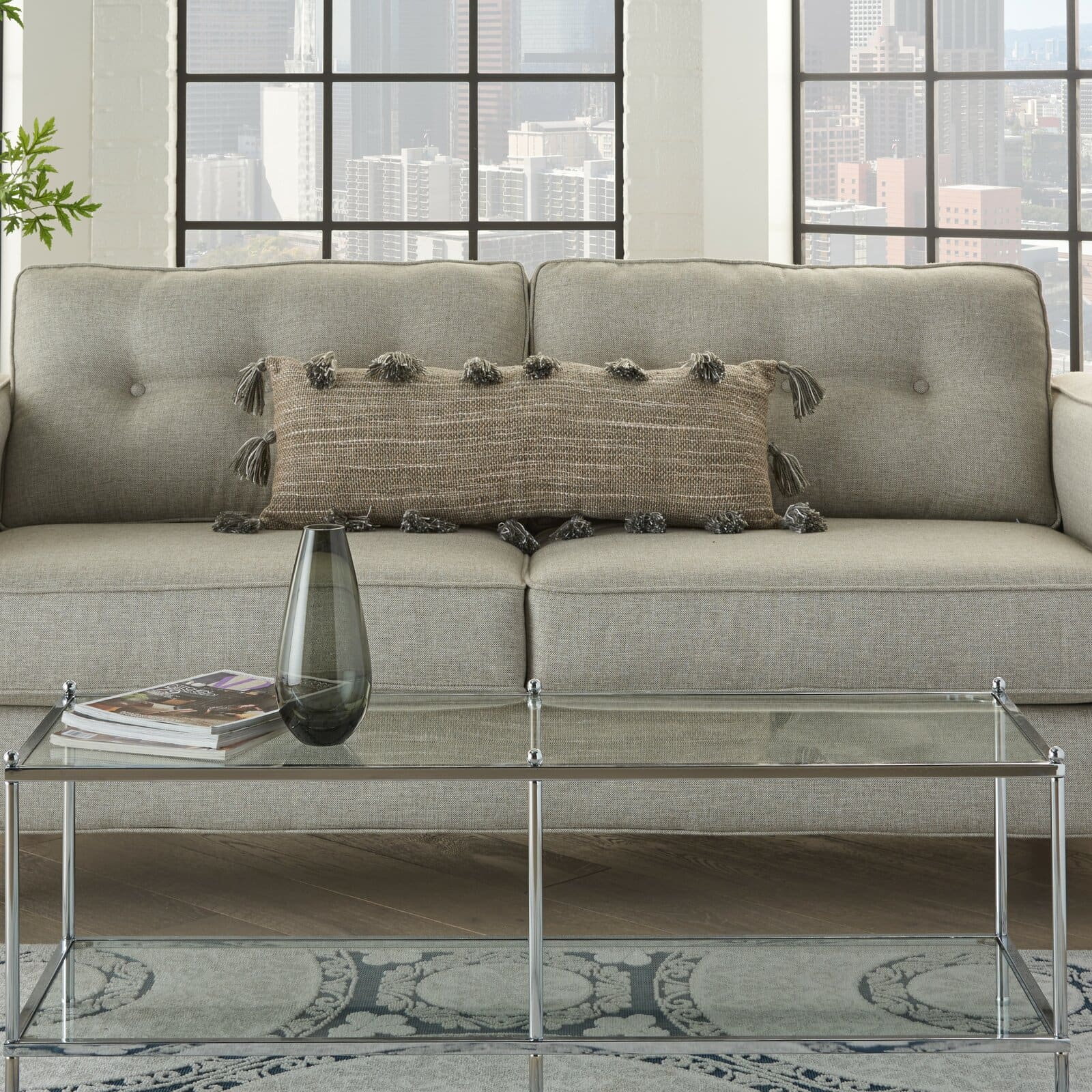 Add Some Fun to a Plain Grey Sofa With Tassels
