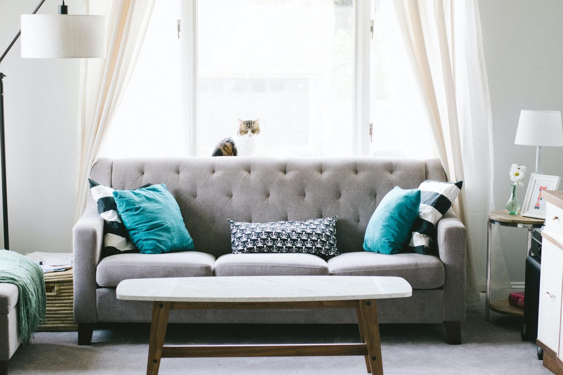 Turquoise Pillows With A Grey Sofa For a Calm Feel