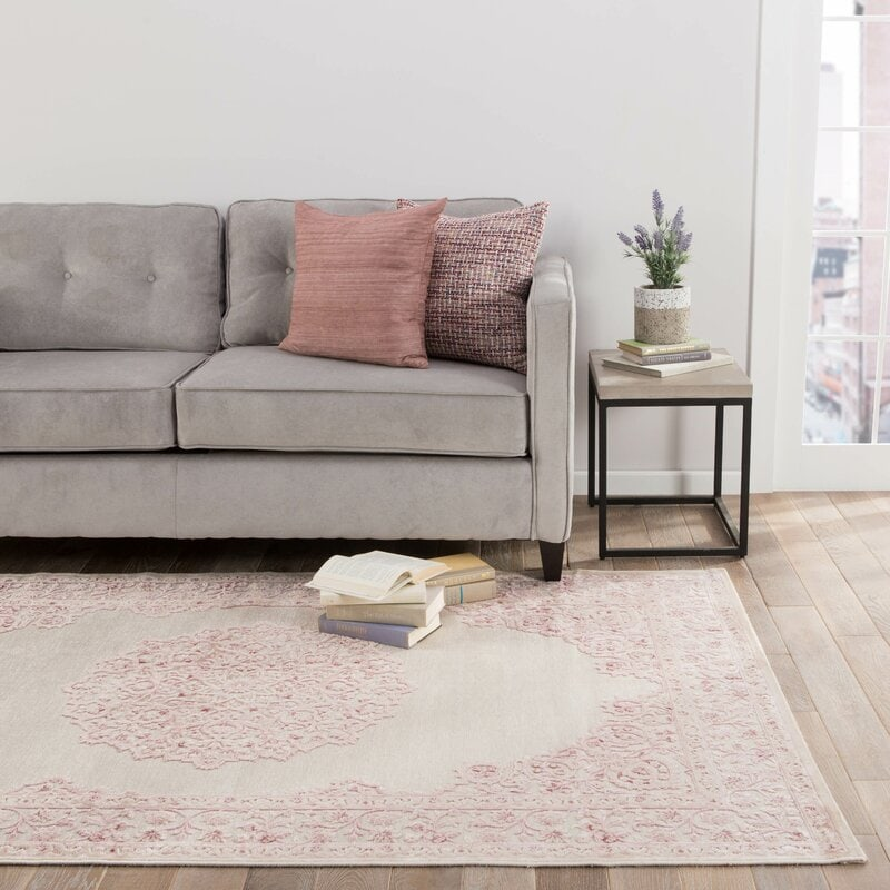 Blush Pink Throw Pillows on a Grey Couch For a Touch of Feminine Chic