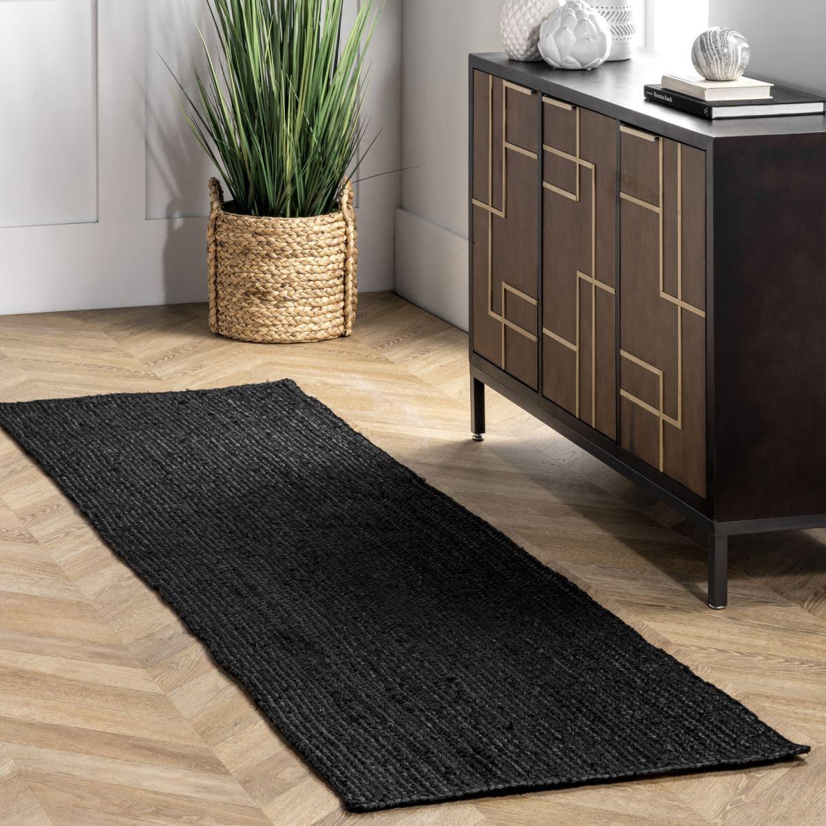 Create Contrast on Light Floors With a Black Rug