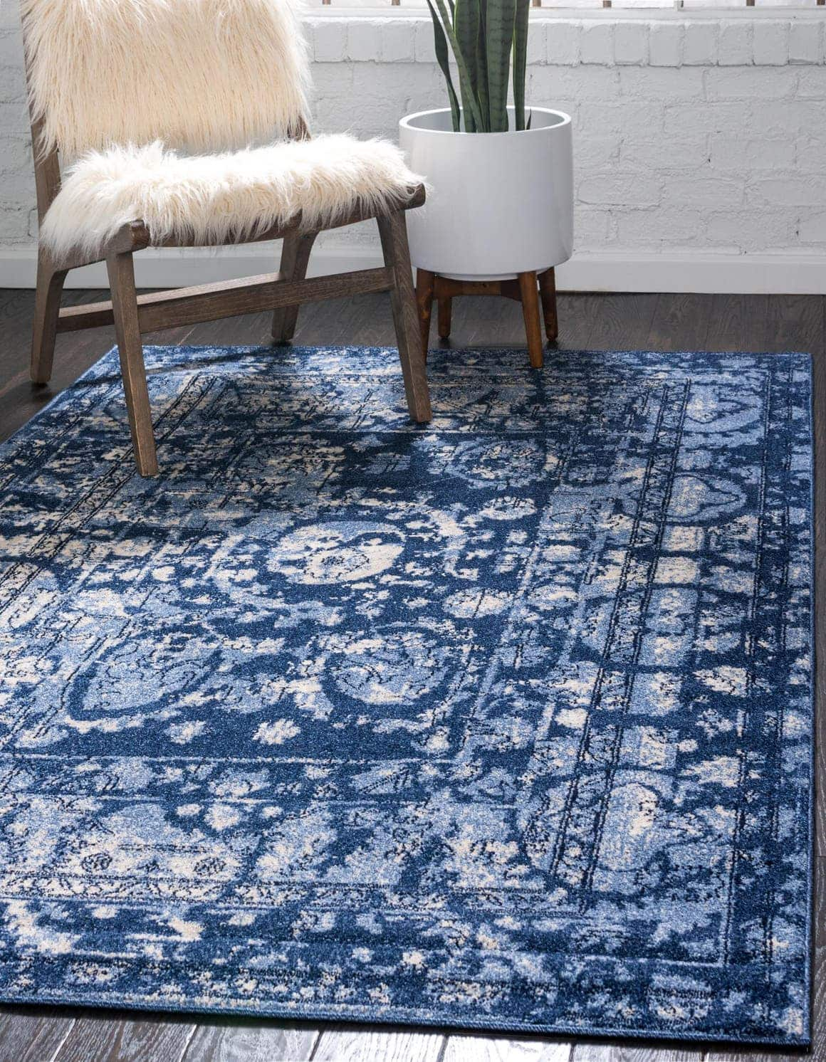 Use a Cool Blue Rug on Dark Wood for a Chic Vibe