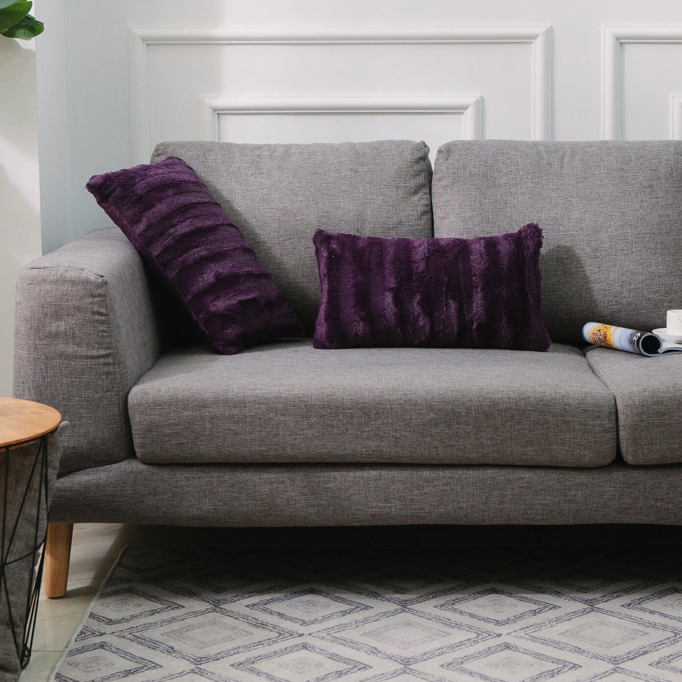 Grey Couch With Purple Throw Pillows