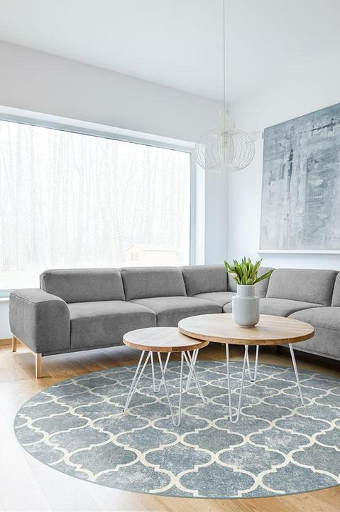 A Round Area Rug With a Large Sectional Sofa