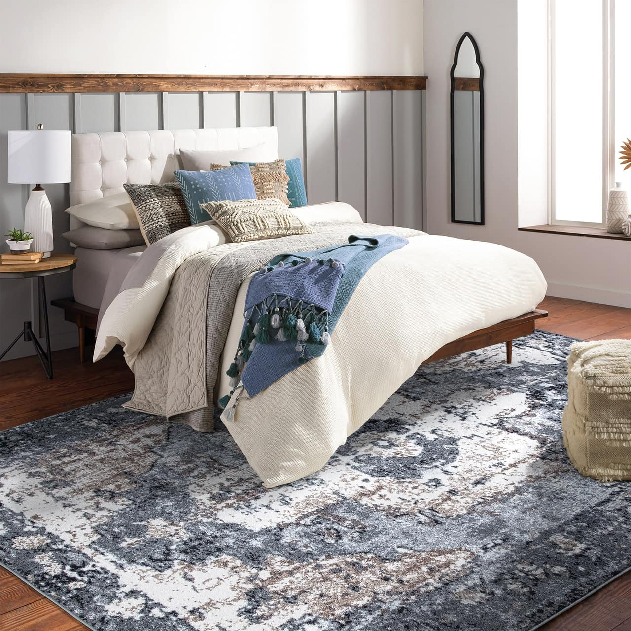 """7'10"""" x 10'3"""" Rectangle Rug Underneath a Queen Bed"""