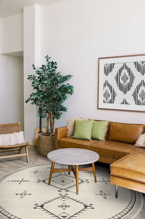 Round Rug Centred in Front of The Sofa