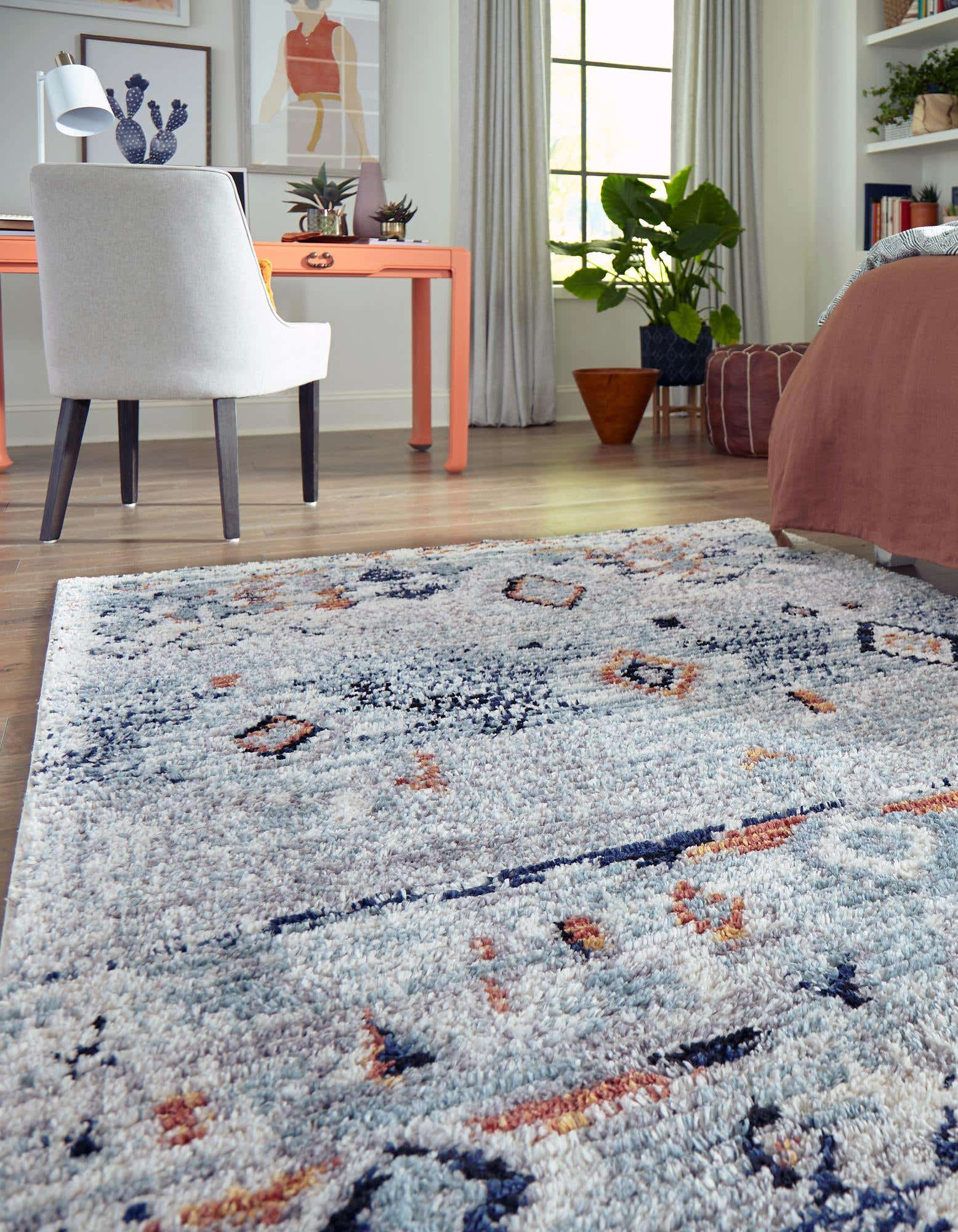 <strong>Place a Smaller Rug at the End of your Bed</strong>