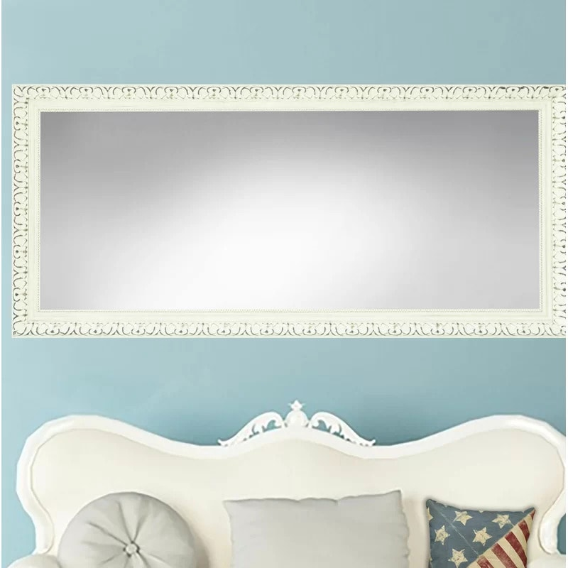 Go For a Classic Look With a Distressed White Framed Mirror